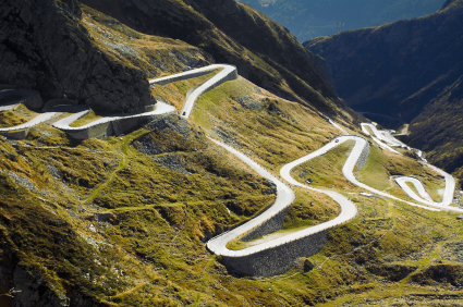 Winding road symbolising how processes slow us from rushing to solutions.
